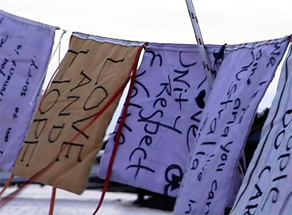 Hand made flags with messages of hope and love made by the people of Australia flew on Eureka and One Off.