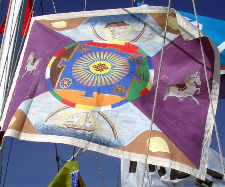 Mandala flag flown on Eureka's mast was designed and painted by Lynda Smith (Ground Crew) and Karen Connors (a student of Buddhism).