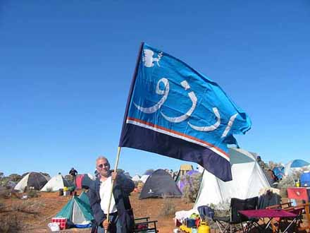 Stavros with Hope (in Farsi language) flag at the Baxter Camp.