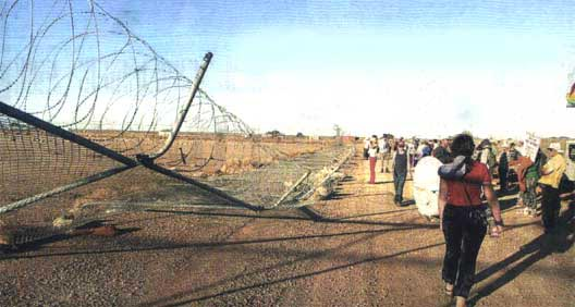The first razor wire fence to fall on the way to supporting the refugees.