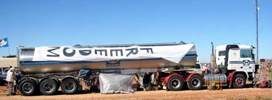 We had to bring our own water because we were in the desert. This is our water tank draped over by HOPE Caravan's FREEDOM Banner.