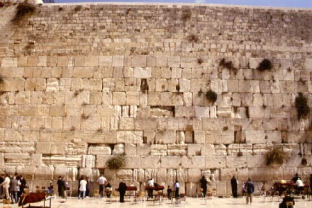"This is the holiest shrine of the Jewish world. The Western Wall is part of the retaining wall supporting the temple mount built by Herod in 20 B.C. After the destruction of the Second Temple in 70 A.D., Jews were not allowed to come to Jerusalem until the Byzantine period, when they could visit once a year on the anniversary of the destruction of the Temple and weep over the ruins of the Holy Temple. Because of this, the wall became known as the ""Wailing Wall."""