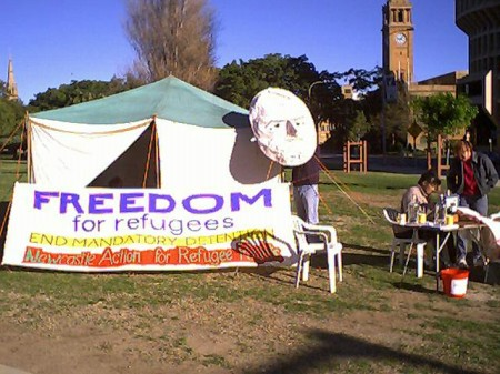 NARR conducted a sympathy fast with the hunger strikers at Woomera Detention Centre in 2002. This is the tent we lived in at Civic Park, Newcastle. The head on the corner is a paper mache of Philip Ruddock, the Immigration Minister at the time.